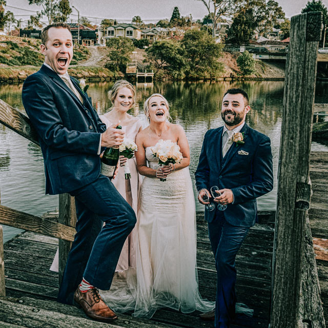 Melbourne wedding photography image of bridal party having champagne at Yarra Valley