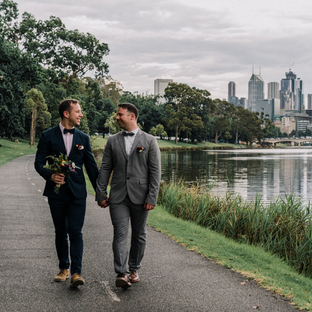 Melbourne gay marriage couple walking down the Yarra river for gay wedding Australia photo by Black Avenue Productions