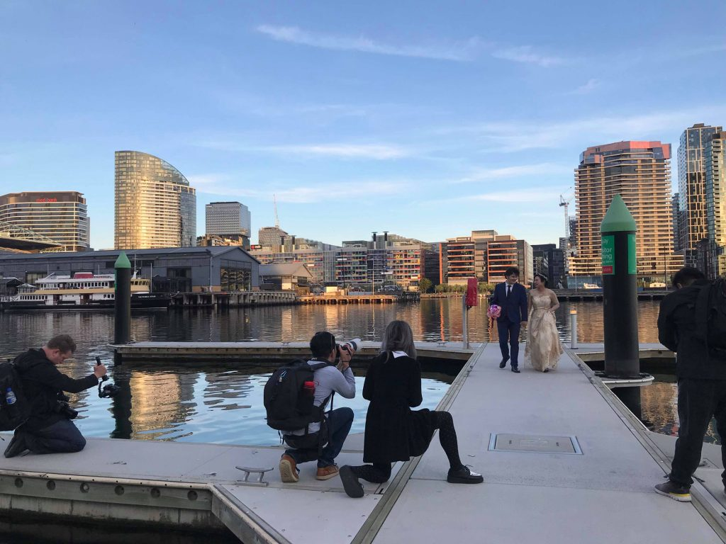 Behind the scene photo of Black Avenue Productions shooting a wedding photography and videography shoot in Docklands Melbourne
