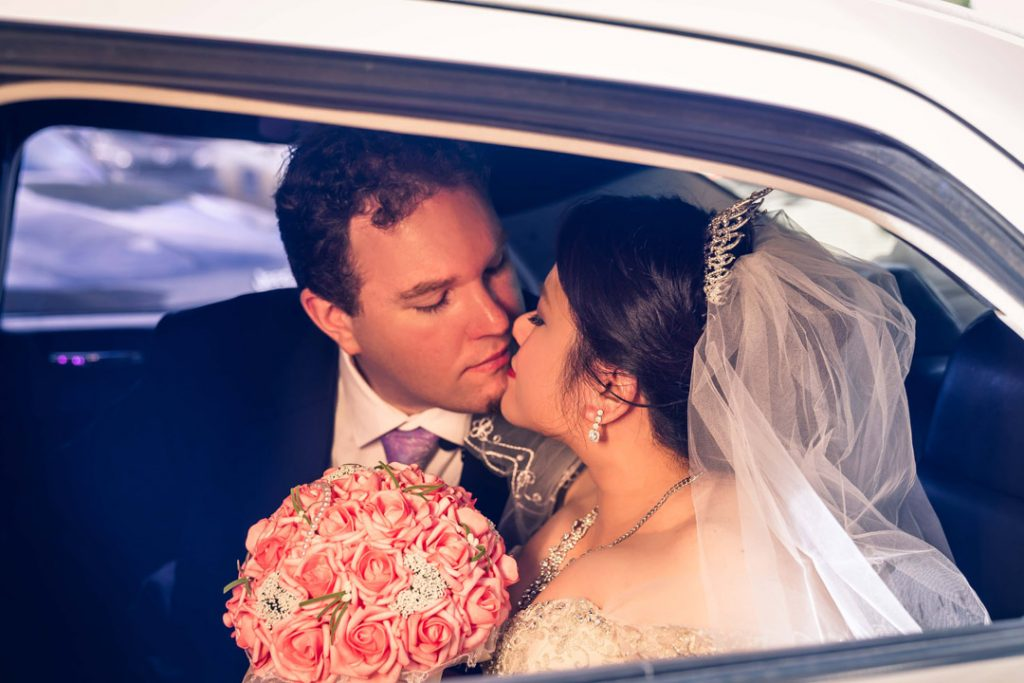 couple kissing in a Amazing Limousines to Merrimu Receptions by Melbourne wedding photographers