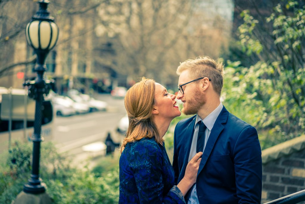 Melbourne wedding photographer captured passionate couple talking to each other in Collins Street Melbourne CBD