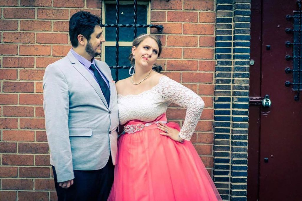 funny wedding photo at Fitzroy Garden with couple pulling silly faces 2017