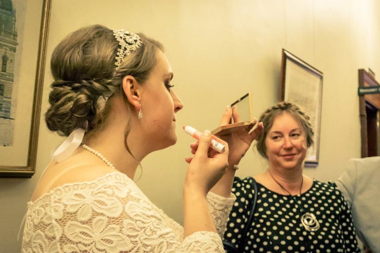 off beat bride wearing her lipstick before wedding ceremony inside Victorian Marriage Registry 2017 by Black Avenue Productions