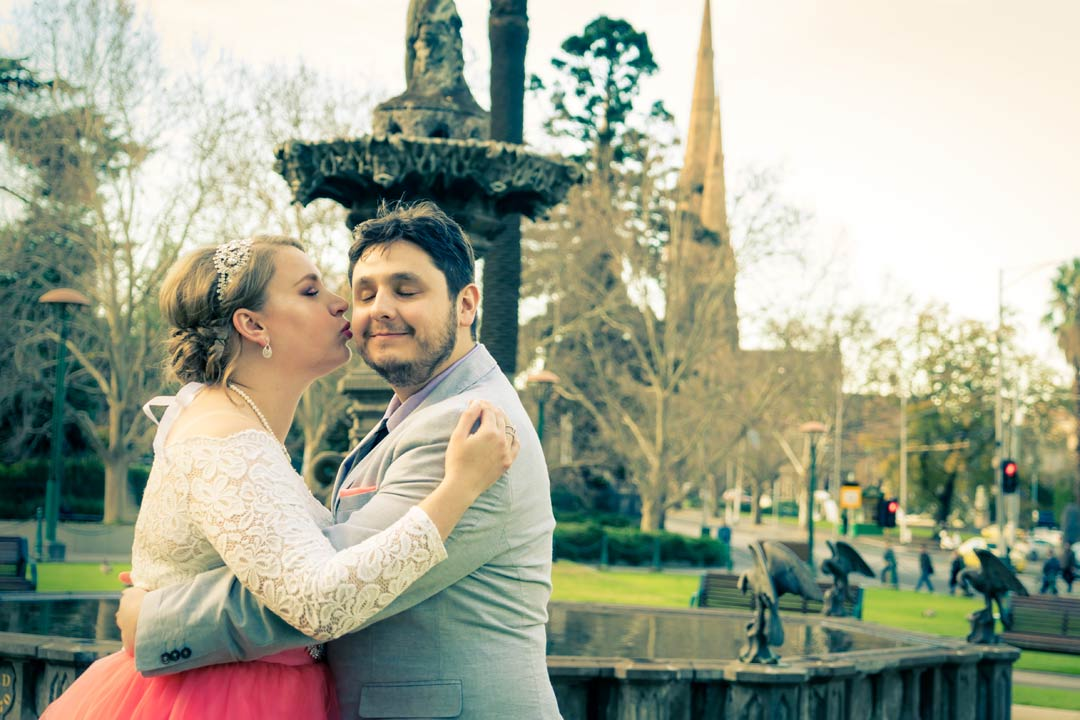 engaged couple hugging each other by water fountain near Botanical Garden Melbourne wedding venue 2017
