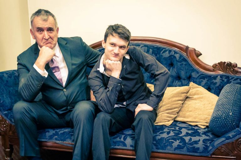 Father and son sat at antique sofa inside Victorian Marriage Registry Old treasury building Melbourne 2017 for family wedding photography