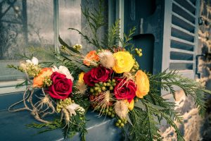 colourful Australian woodland forest theme wedding florae bouquet and flower crown detail photo