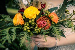 close up of a bride holding a boho wedding theme flower bouquet
