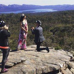 proposal photography showing behind the scenes image of female wedding photographer Lowina Blackman shooting candid moment of a surprise proposal at the Grampians Australia 2017 Summer