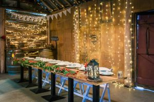 bridal table in rustic greenery wedding reception setting with fairy lights and forest plants in Melbourne Baxter Barn