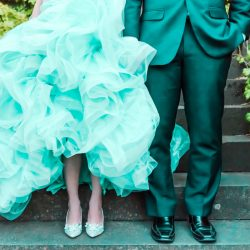 bride wearing Tiffany blue wedding dress and Jimmy Choo bridal shoes standing with groom in suit