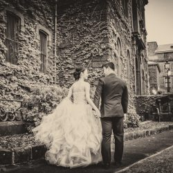 candid fun bride groom walking moment captured by Black Avenue Productions