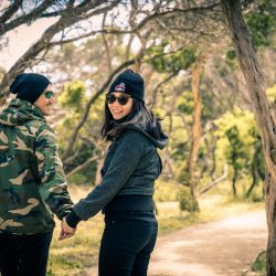 romantic travellers couple hiking in the forest captured by Melbourne wedding photographers Black Avenue Productions