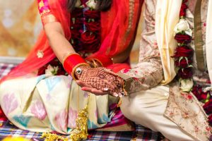 couple with their henna tattoo holding hands during Hindu wedding ceremony captured by Black Avenue Productions