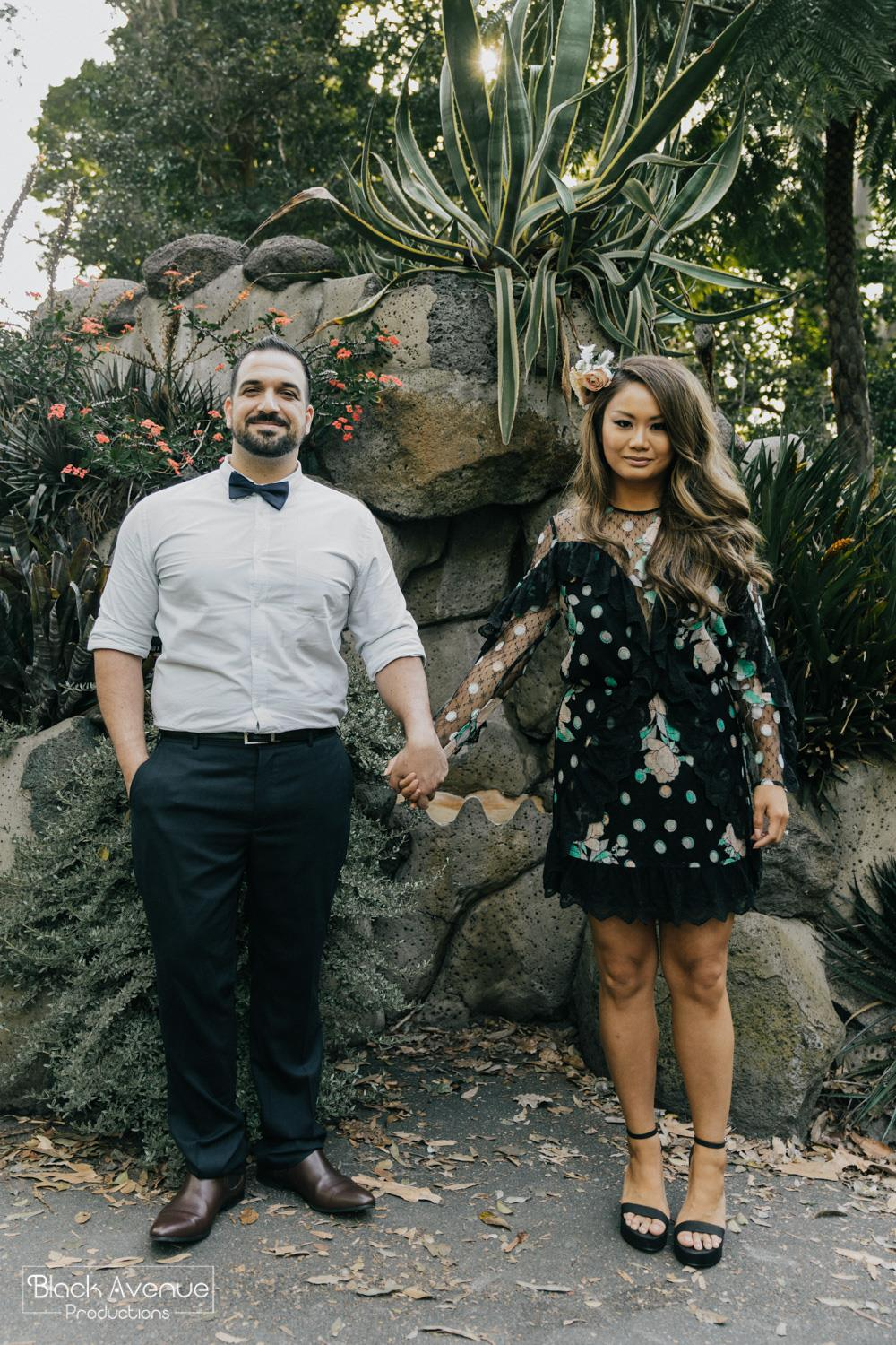 newly engaged couple holding hand posing for their Royal Botanical Gardens engagement photos session by Black Avenue Productions in Melbourne