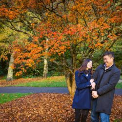 Engagement photography example of how romantic to have pre wedding photos by a red forest in a relax atmosphere