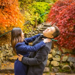funny couple having fun during their pre wedding photo at Mt Dandenong Ranges Melbourne by red leaves trees