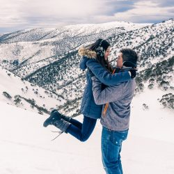 boyfriend pick up girlfriend at a ski trip for their pre wedding photo in Melbourne Australia during Winter