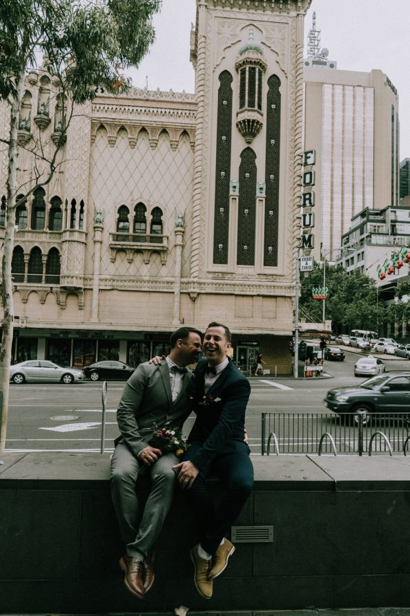 gay couple celebrating love outside Forum in Melbourne CBD flinders street