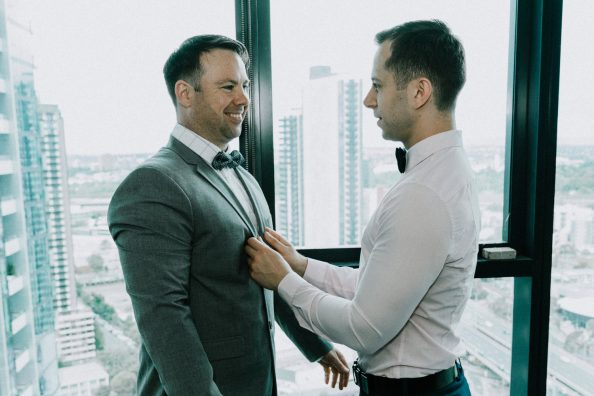 in love gay couple helping each other to get ready for wedding ceremony in Melbourne Australia