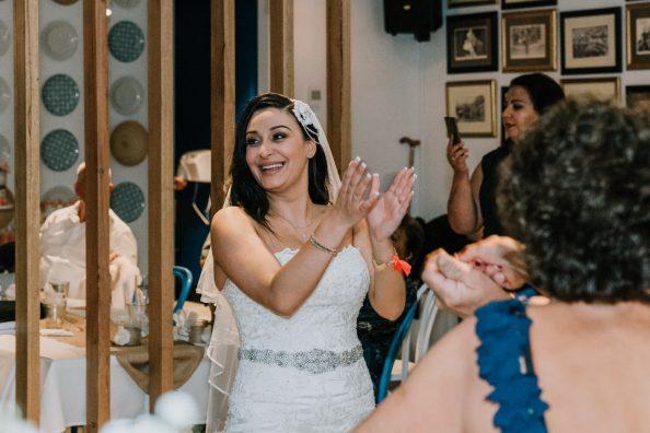 happy bride clapping on the dance floor at Brighton Savoy wedding reception venue