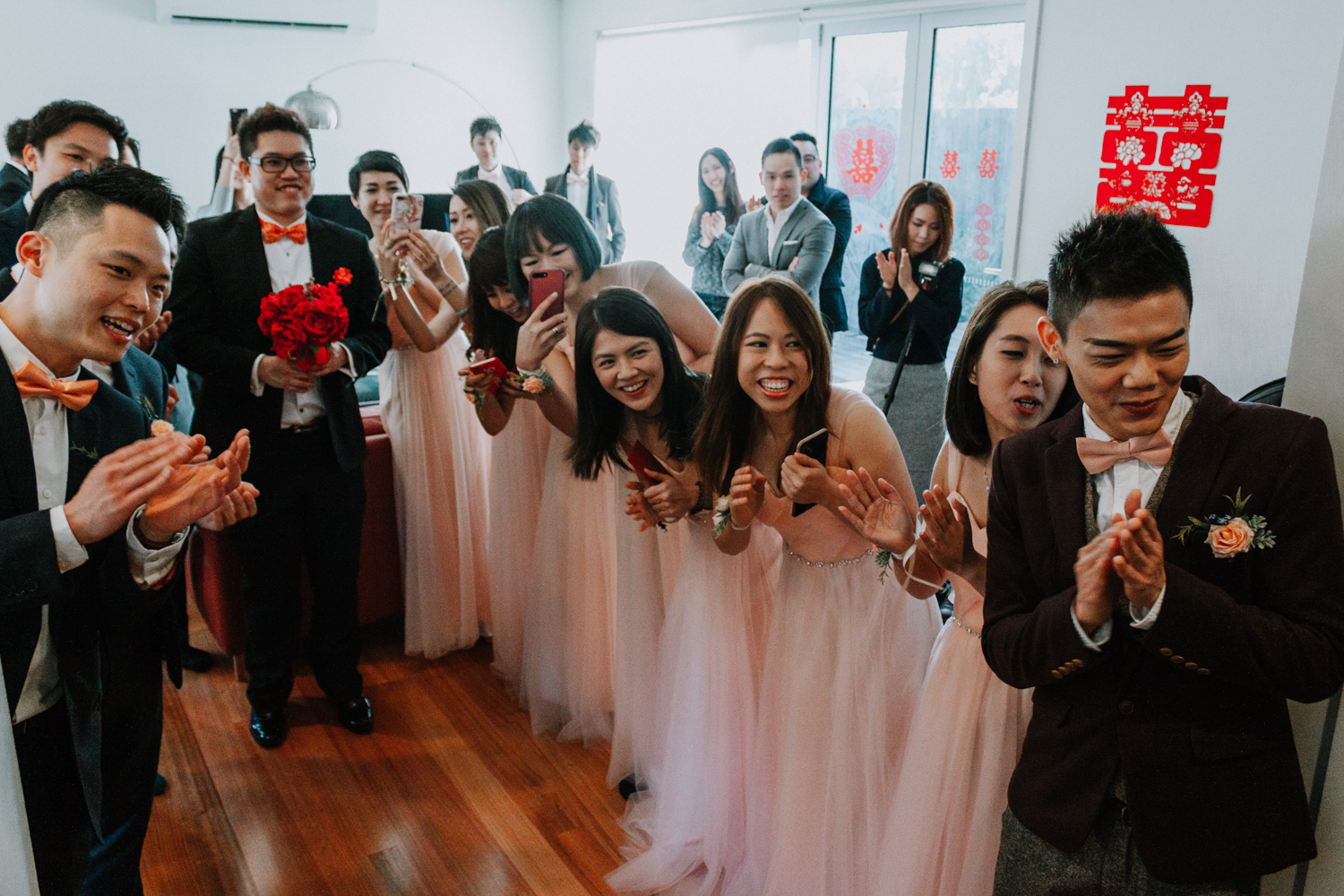 bridal party welcome newly wedded husband wife to wedding reception natural wedding photo moment taken by Melbourne wedding photographer Black Avenue Productions