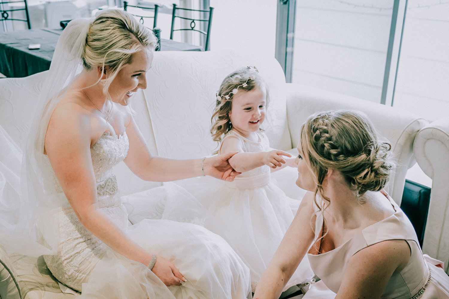 Candid vs Traditional Wedding Photography image showing bride having fun with flower girl captured by Black Avenue Productions