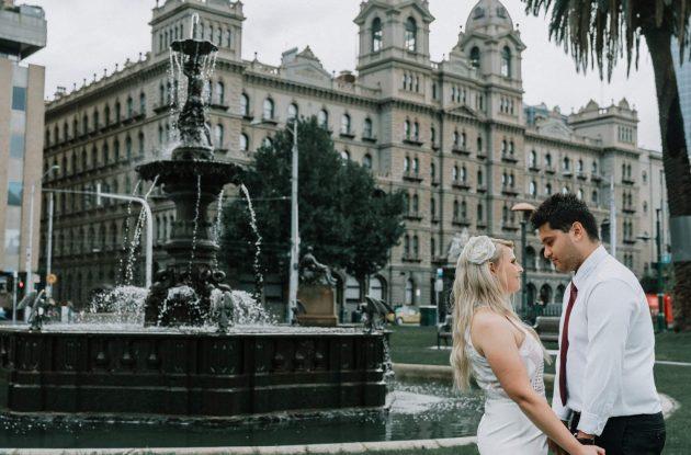 romantic wedding photo outside Old Treasury building fountain