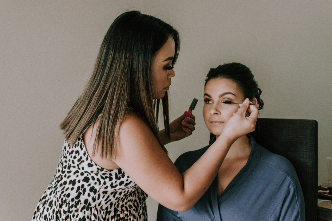 wedding makeup artist Crystal putting mascara on Melbourne bride