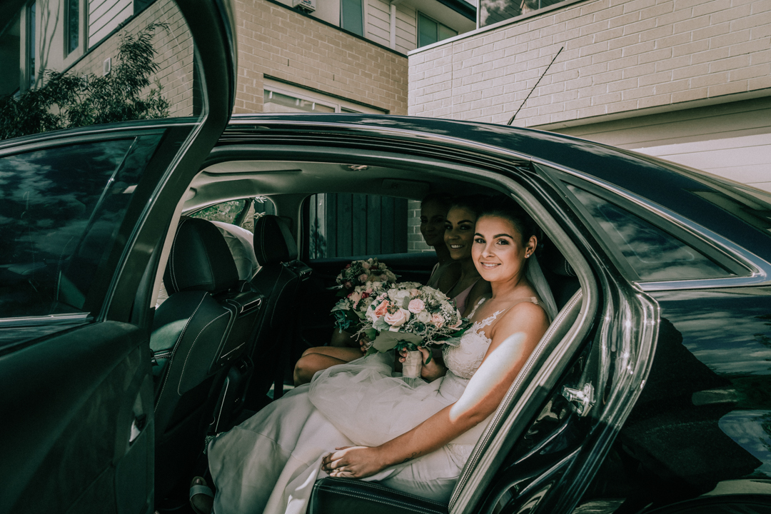 bride walk out of wedding limo at Mornington Peninsula