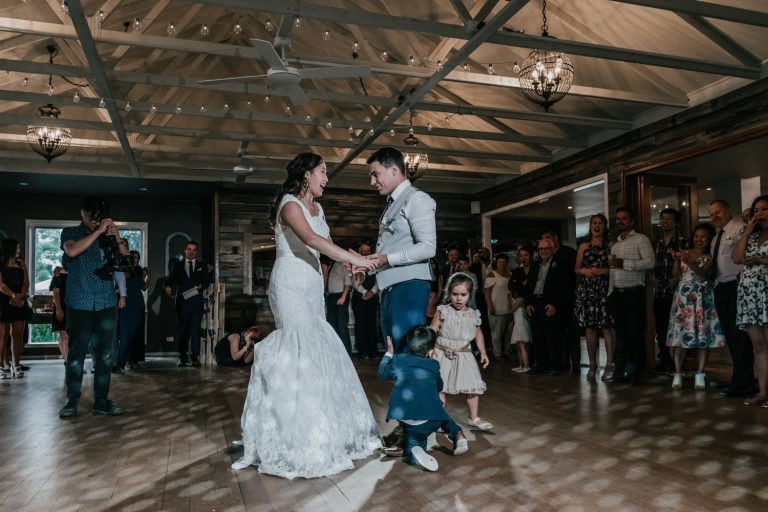 toddler's cousin tell baby to get off the dance floor while bride and groom is having first dance