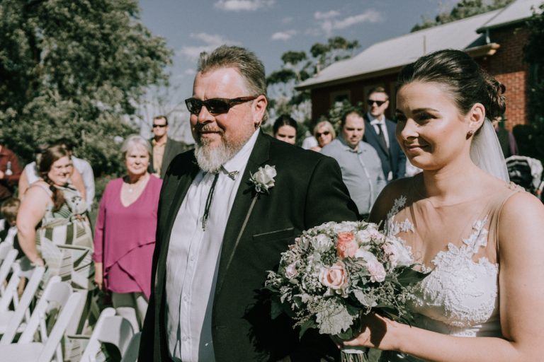 father and daughter walking down the aisle in The Briars