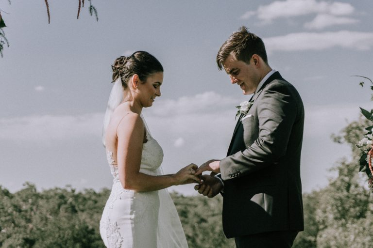 husband and wife exchange wedding rings moment captured by Melbourne wedding videographers Black Avenue Productions