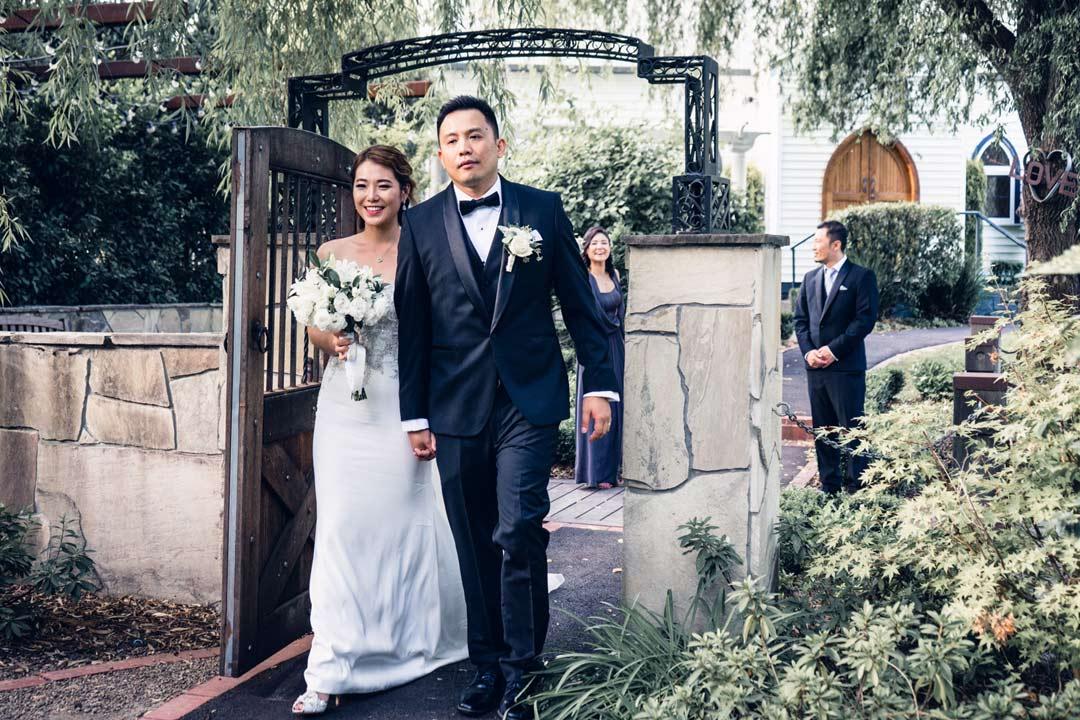 bride and groom walking in gardens of Ballara Receptions