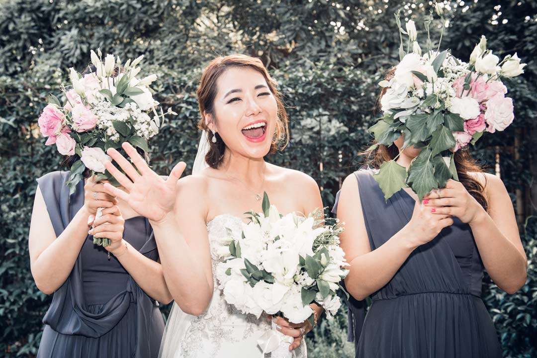 beautiful Korean bride and bridesmaids holding flower bouquets