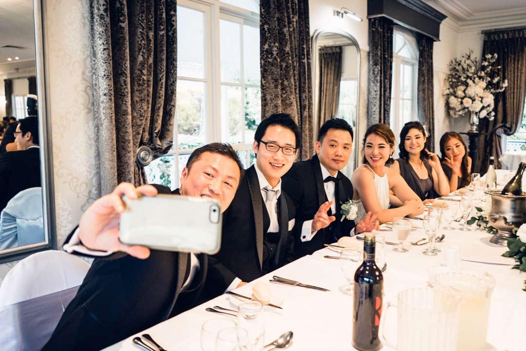 bridal party taking selfie at bridal table at Ballara Receptions in Eltham