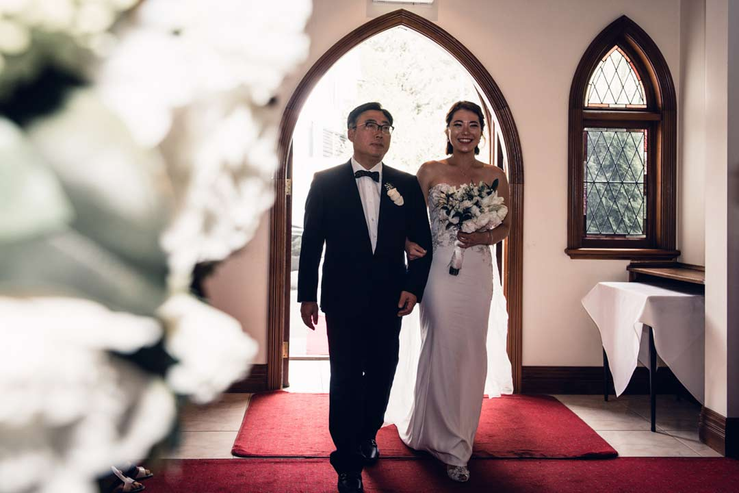 father walk down the aisle with bride at Ballara Receptions wedding venue chapel