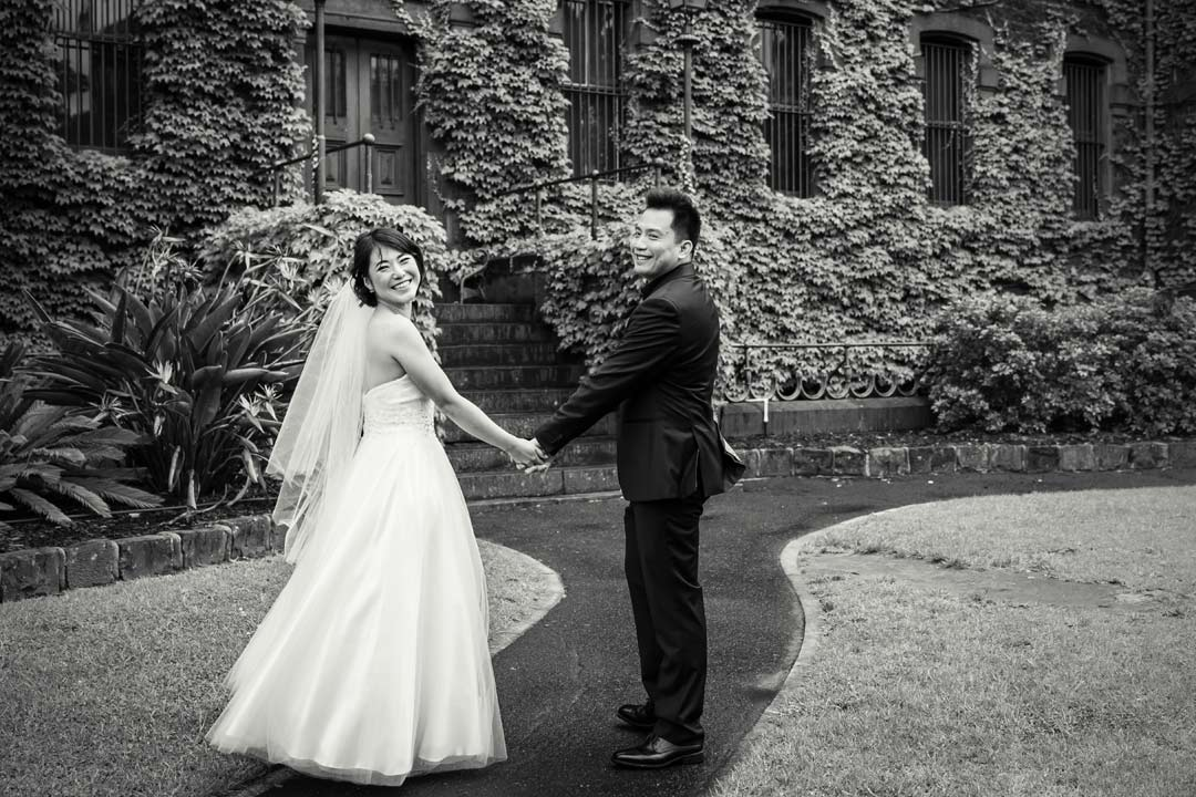 Melbourne wedding photographers Black Avenue Productions took this candid shot of bride and groom walking at Victoria Barracks for pre wedding photo