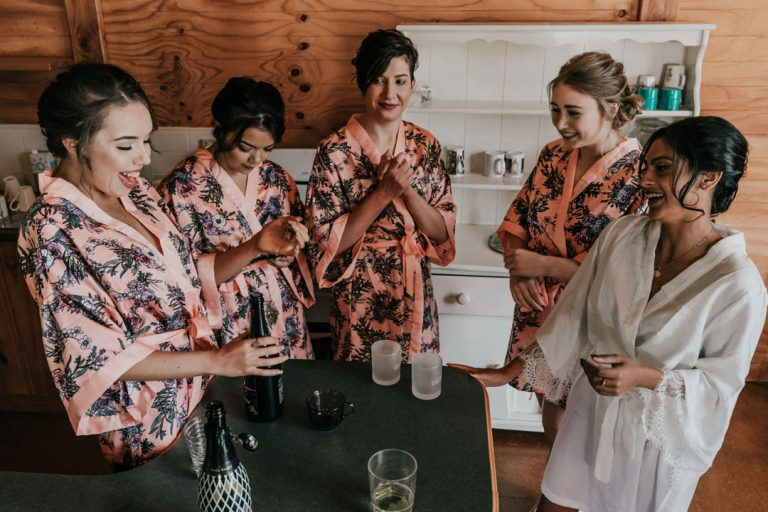 bride and bridal party getting ready photo