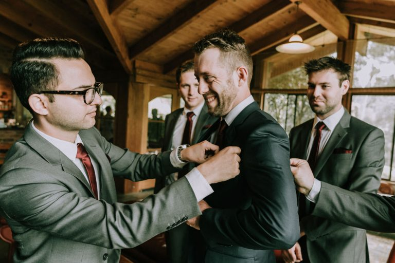 groom getting ready photo in rustic farmhouse wedding in Australia