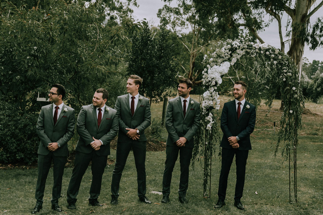groom and groomsmen waiting for bride to walk down aisle candid moment by Black Avenue Productions
