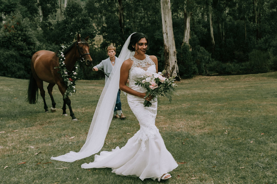 bride walk down the aisle with a horse at rustic farm wedding Melbourne