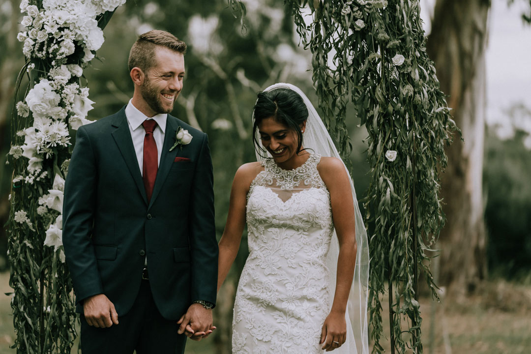 happy moment of bride and groom taken by Melbourne wedding photographers Black Avenue Productions