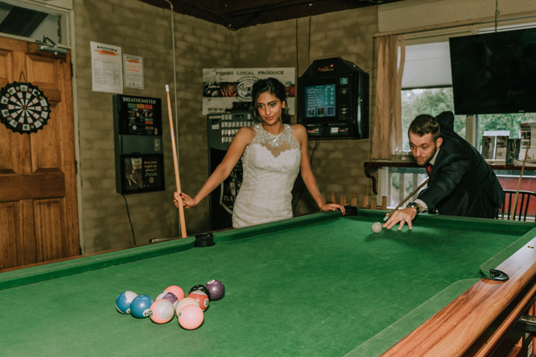 cool wedding photo of bride groom play snooker in Buxton Hotel Victoria Australia