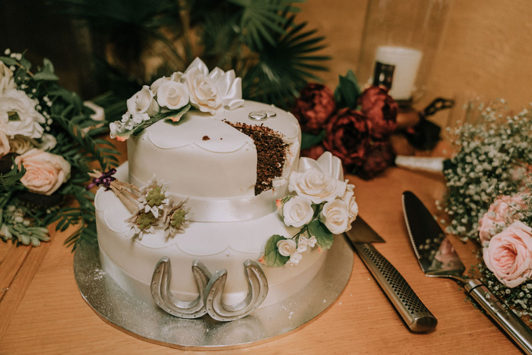 rustic farm wedding cake with horse