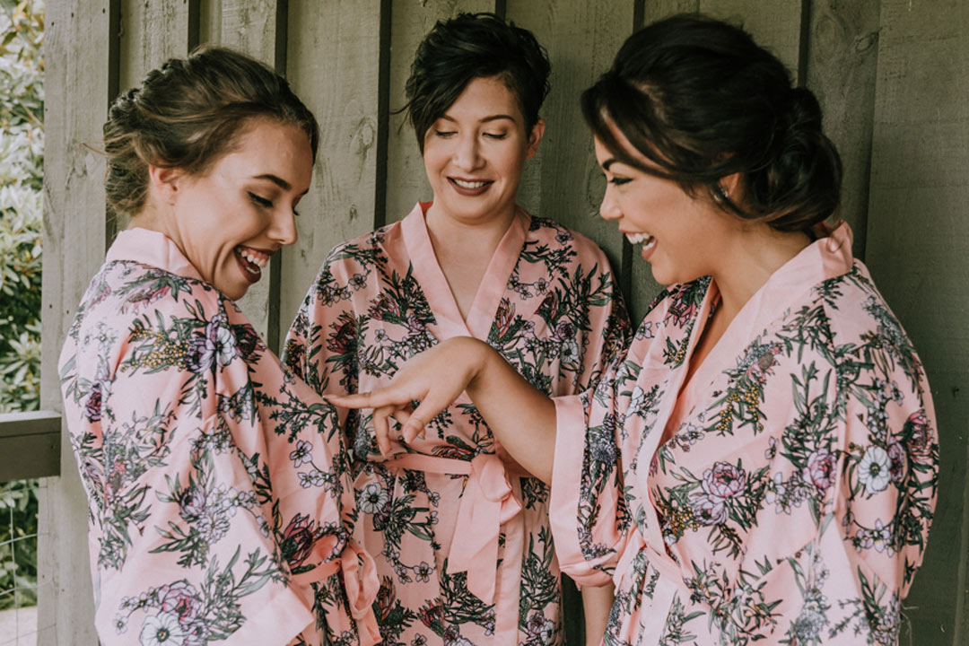 bridesmaids in bridal party robes in rustic farmhouse in Victoria