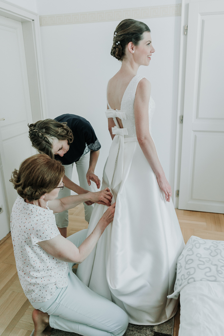 mother and sister help bride prep in Europe on wedding day captured by Black Avenue Productions