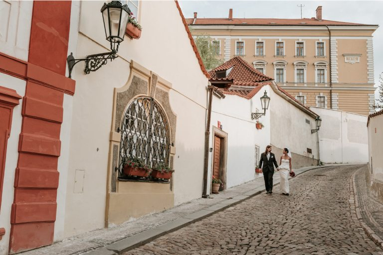 Newly wed couple walk around the cobblestone for their Prague destination wedding photography session with Derek Chan and Lowina Blackman from Melbourne Australia