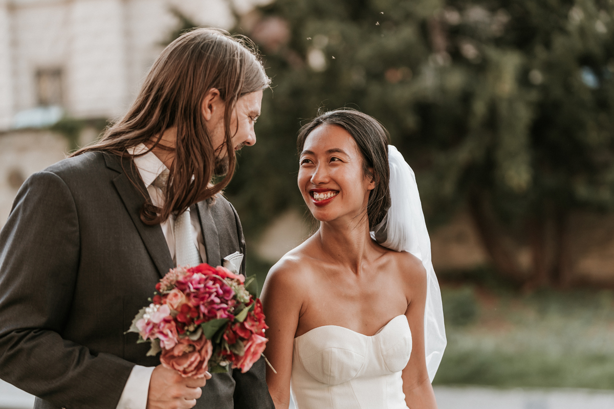 Prague destination wedding photographers from Black Avenue Productions captured the moment of newly wednesday husband and wife look into each other