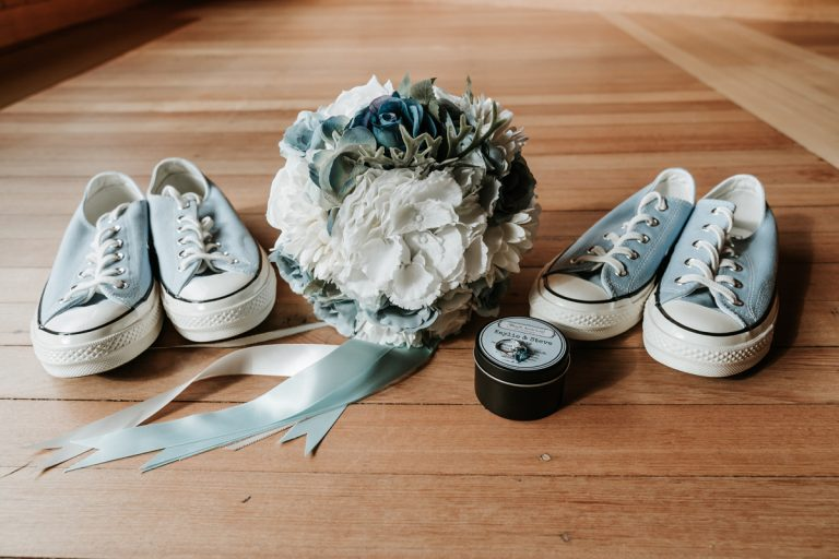 blue theme wedding items featuring converse and flower by Black Avenue Productions from Melbourne