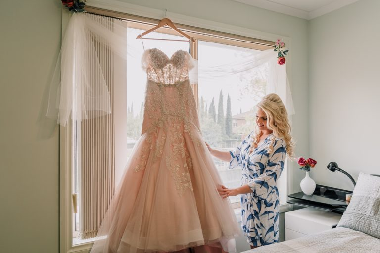 bride and bridesmaids getting ready in their Melbourne home captured by wedding photographer Derek from Black Avenue Productions
